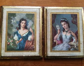 Vintage Pair of Italian Antiqued Florentine Plaques, Made in Italy Gold Frame Woman with Crossbow and Woman with Mirror Blue and Gold