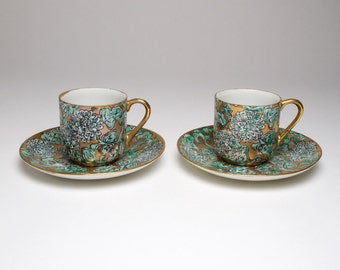 Pair of Vintage Chinese eggshell porcelain cups and saucers.