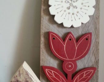 Salvage folk art flowers wall art for inside or out.