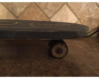 Vintage roll a  board skateboard