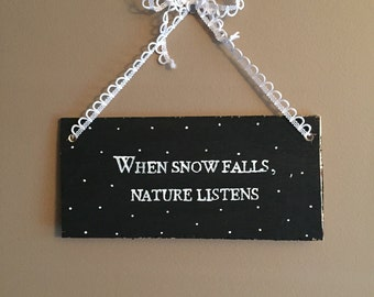 When snow falls nature listens sign