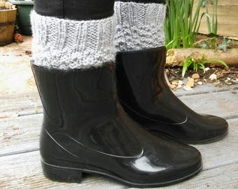 Light gray boot cuffs, ankle warmers.