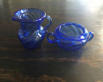 Rich blue glass creamer and sugar bowl
