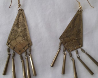A pair of dangle pierced earrings with fringe.
