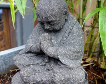 Bowing monk statue made of volcanic ash (0032)