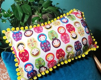 Nesting dolls pillow with yellow fringe