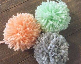 Set of Three large 3 inch Yarn Pom Poms, Gray, Peach, Mint, Party Decor, Gift Topper, Nursery Decor