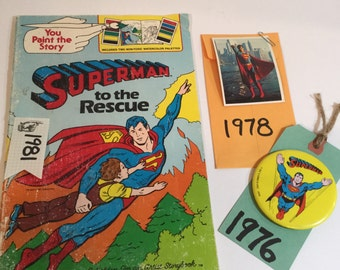 Vintage Superman collectibles Paint w Water Book 1981, Pin back button badge 1976, comic card #2 from 1976 DC Comics collectibles
