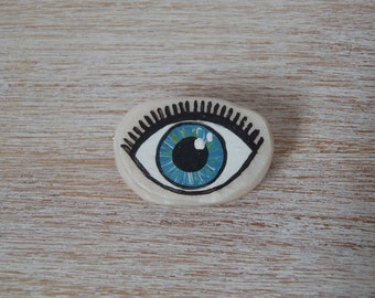 Handpainted polymer clay blue eye brooch