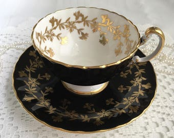 Aynsley China Tea Cup and Saucer, Black with Gold Gilding and Trim