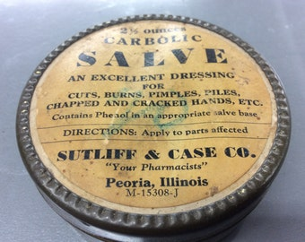 This salve container is in good condition and still has a little left in it