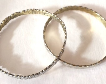 2 Vintage Mexican sterling bracelets with gold wash interior