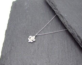 Mini CZ fleur de lis pendant on chain, Sterling Silver