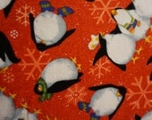 Roly Poly Penguins - Red; sold by the yard