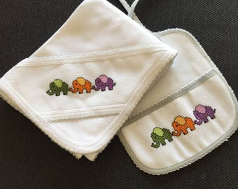 Cross stitched set of baby bib and baby blanket.