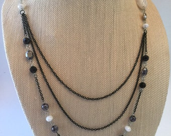 Black and with triple chain