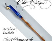 Oblique Pen Holder, Blue Acrylic body with a cocobolo tail.