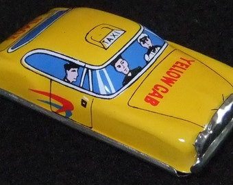 Yellow Taxi Cab tinplate toy car vintage c1960s? by Lucky Toys made in Japan