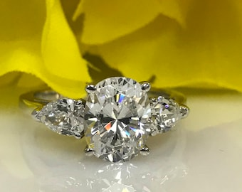 Moissanite 3.00ctw. Oval And Pear Shape Three Stone Engagement Ring In 14K White Gold #4917