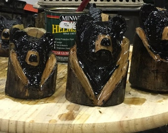 Chainsaw carving bear head carving
