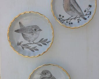 Set of three small bowls with birds