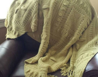 Green hand-knitted afghan. Beautiful addition to your home