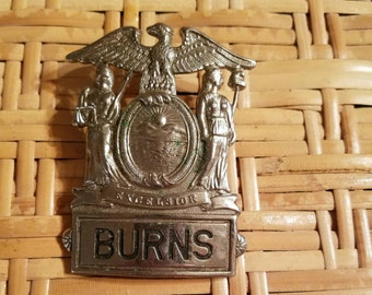 Burns security  Hat  Badge