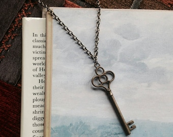 Bronze key necklace // key charm // antique bronze // vintage style // skeleton key pendant // romantic // gift for her // fairytale