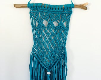 Teal green handmade macrame wall hanging/decor made with trap-art t-shirt/tshirt yarn and hung on eucalyptus branch