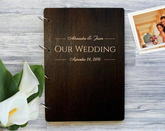 """Wedding photo album in a wooden cover """"Our Wedding"""""""