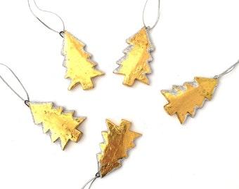 Five golden Christmas Tree Decorations