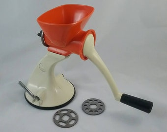 Vintage Mincer. Cream and orange. Suction bottom mincer. Metal and plastic. 1960s-70s. Salter mincer.