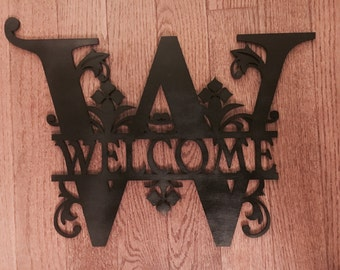 Monogram welcome sign or photo wall are