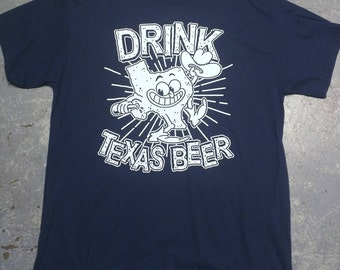 Drink more local beer!!! This is one of our original shirts. Support your local breweries. We carry over 30 local Houston beers currently.