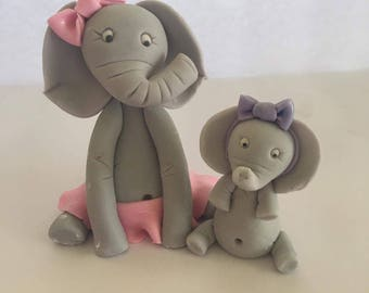 Mommy and baby elephant cake topper made out of fondant