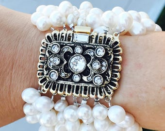 Vintage Swarovski crystal  clasp fresh water pear wedding custom made bracelet. Made to fit every wrist. Makes a fashion statement.