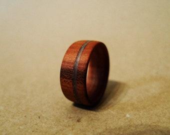 Handmade wooden ring made of cherry wood