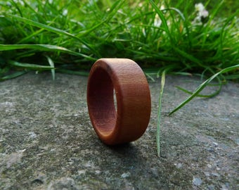 Handmade wooden ring made of cherry wood
