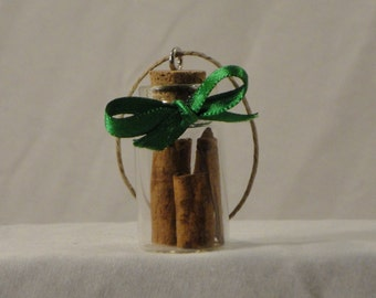Charm bottle filled with cinnamon sticks Ornament