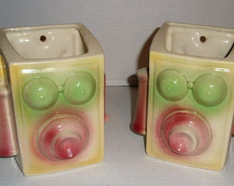 Two Shawnee Telephone Wall Pockets.  Planters.  Vases.