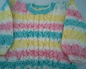 Lovely cabled pattern hand knitted baby girls jumper 6-9 months cabled jumper