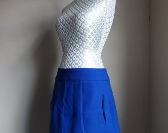 Amazing royal tailored blue mini skirt, UK 10. Hip hugging, functional pockets.