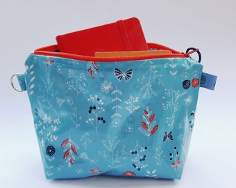 Turquoise zippered oilcloth pouch