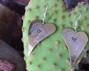 Heart-shaped brass earrings with sterling silver design