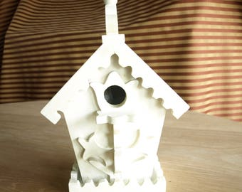 White Birdhouse with Decorative Floral Patterns, edging and finials