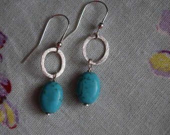 Earrings made of sterling silver and howlite pearls