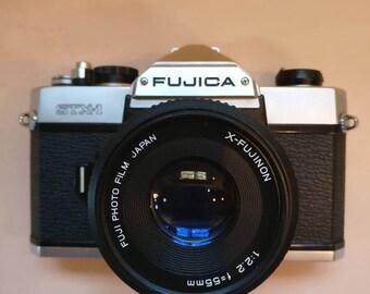Vintage Fujica STX-1 SLR Film camera with x-fujinon 55mm lens.