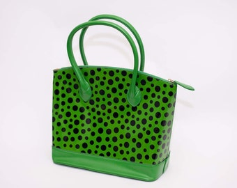 Green & black polkadot handbag