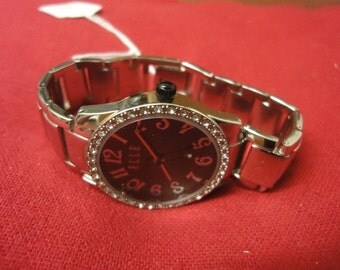 Ladies designer watch by ELLE in stainless steel and black face   very chic