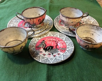 Ohio Art tin dishes / 11 piece/ Swans